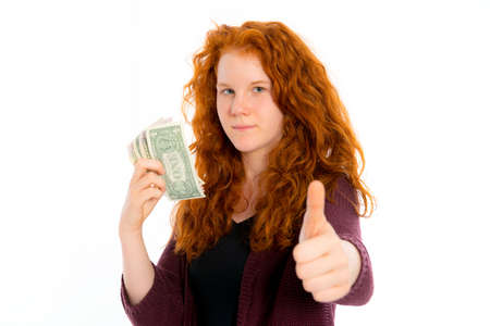 schein: red haired girl with dollars and thumb up