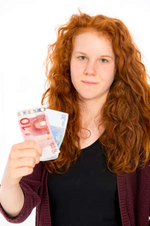 schein: red haired girl with euros is looking in to the camera