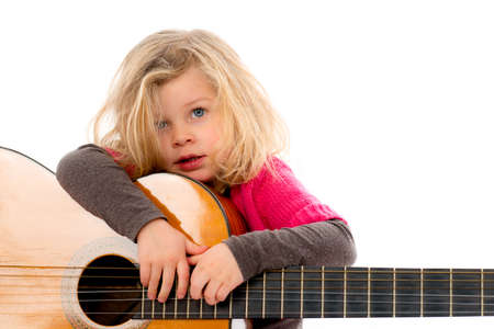 acoustical: little girl is playing with a guitar Stock Photo
