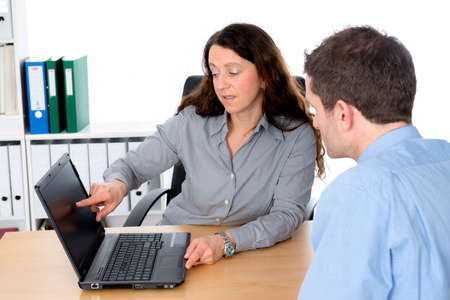 clerical: business woman and man in counseling interview