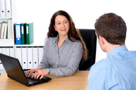 career counseling: business woman and man in counseling interview