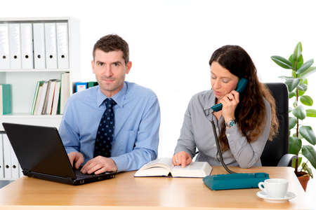 clerical: man and woman together in the office