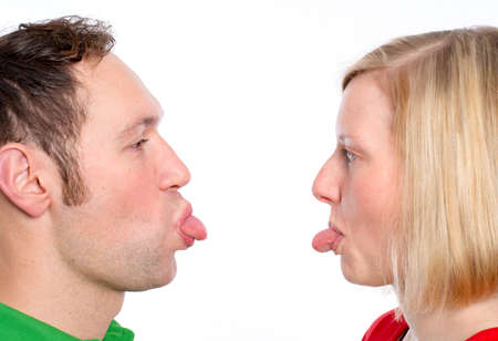poke: young couple heaving fun and poke the tongue out