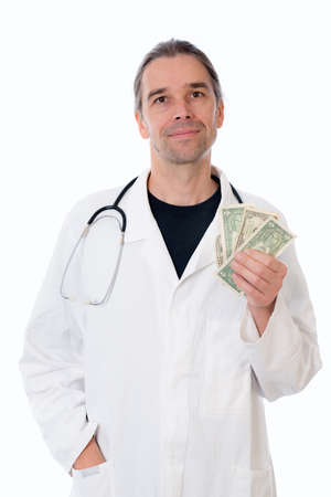 corrupt practice: friendly young doctor with money in white lab coat