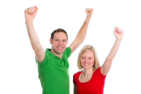 jubilating: young happy couple in front of white background  with arms up