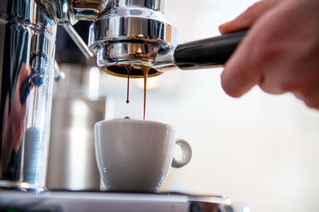 in front: porta filter espressomachine in front of bright background