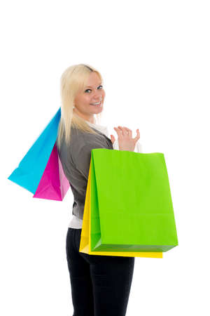 carryall: young blond woman in front of white background with shopping bags