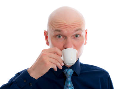 bald head: young man with bald head in front of white background drinking espresso