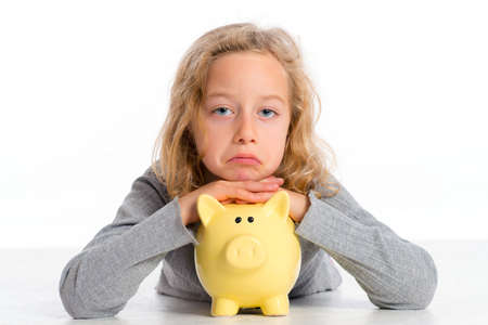 blond girl with piggy bank is not happy photo