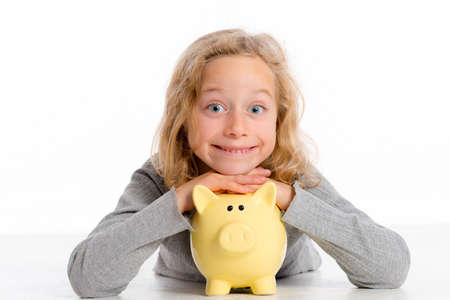 blond girl with piggy bank is happy and smiling