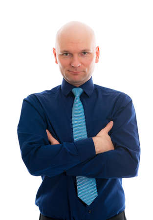 bald head: young businessman with bald head and crossed arms in front of white background Stock Photo