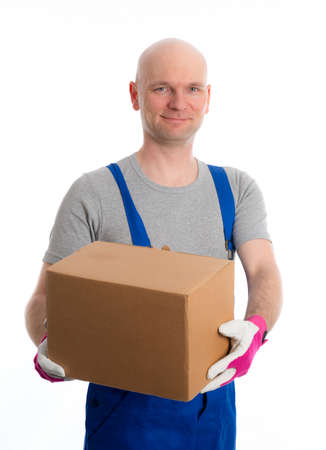 bib overall: young man with bald head and cardboard in front of white background Stock Photo