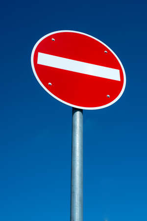 passage forbidden traffic sign in front of blue sky photo