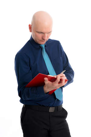 skinhead: young businessman with clipboard in front of white background Stock Photo