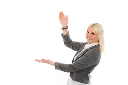 finger on trigger: young blond woman in gray jacket is smiling and pointing sideward
