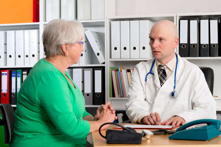 doctor examine: young family doctor examine a female senior