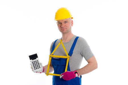 budget repair: worker with yardstick house and pocket calculator Stock Photo