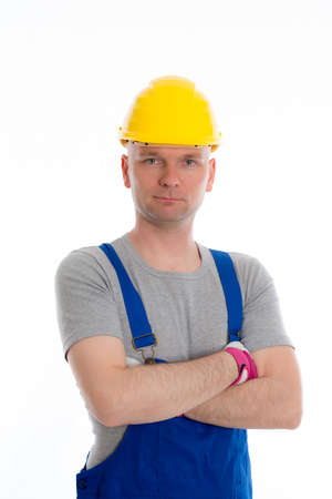 dungarees: young workman in blue dungarees and yellow hard top Stock Photo