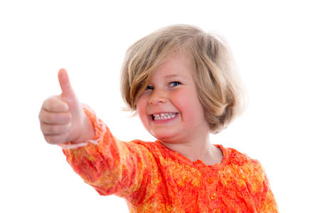 exultant: little girl with thumb up in front of white background Stock Photo