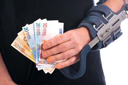 therapie: man with broken arm and euro notes Stock Photo