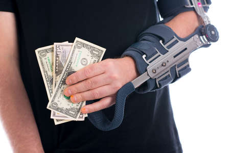 therapie: man with broken arm and dollar notes Stock Photo