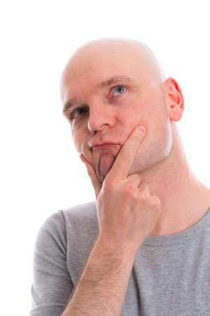 skinhead: funny young man with bald head  is refecting Stock Photo