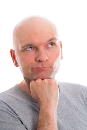 bald head: funny young man with bald head  is refecting Stock Photo