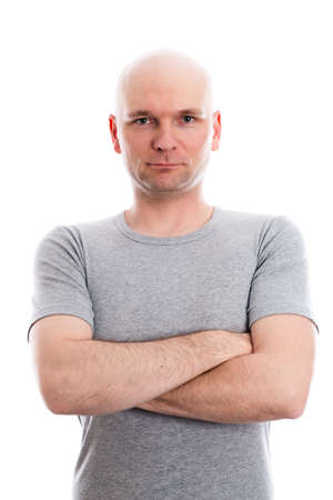skinhead: man with bald head in gray shirt is looking in to the camera Stock Photo