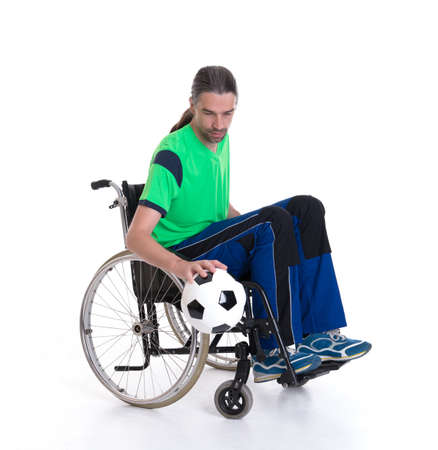 paraplegico: young disabled man in a wheelchair is doing sport with ball