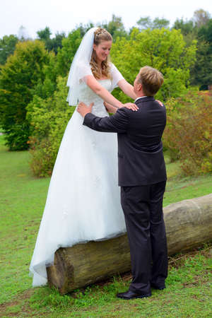 bridal couple: young bridal couple together in front of nature background Stock Photo