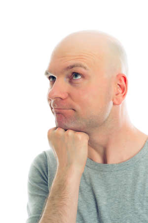 funny young man with bald head  is refacting
