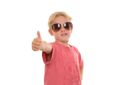 cool boy: cool boy with thumb up in front of white background Stock Photo