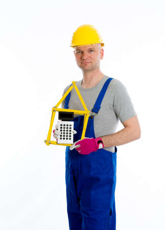 yardstick: worker with yardstick- house and pocket calculator Stock Photo