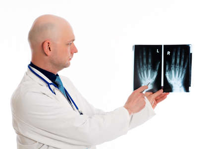 skinhead: young doctor with X-ray photograph in front of white background