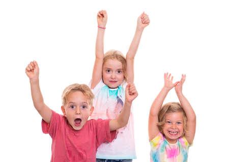 jubilating: funny children jubilating in front of white background