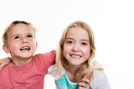 jubilating: two funny children in front of white background