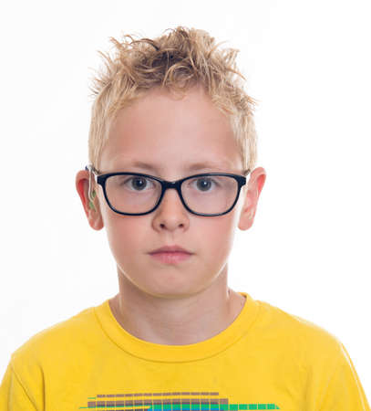 lighthearted: blond boy with hearing aid and glasses
