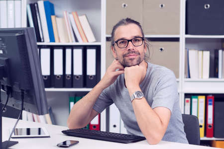 graphics design: creative man is working in his office and looking in to the camera Stock Photo