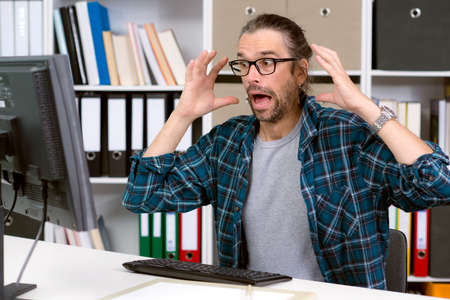 bad news: man in his office has a bad news Stock Photo