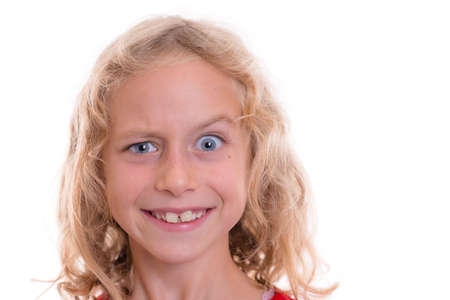 raised eyebrows: nice blond girl looking funny with eyebrow up