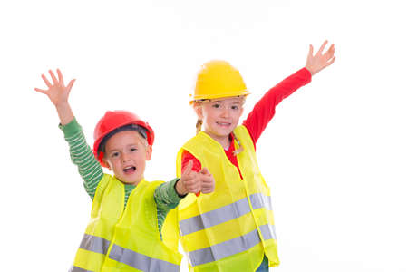 boy and girl with reflective vest and helmet in front of white background 版權商用圖片