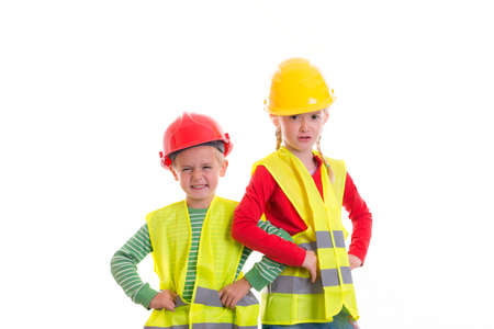 reflective vest: boy and girl with reflective vest and helmet in front of white background Stock Photo