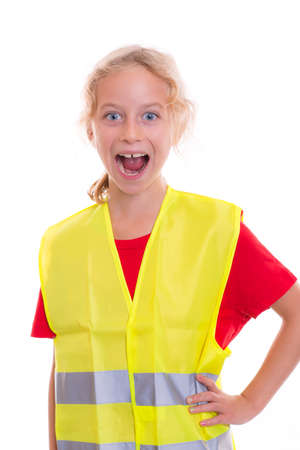 reflective vest: blond girl with reflective vest in front of white background Stock Photo