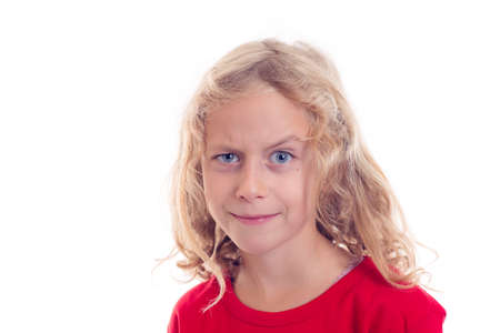 business skeptical: nice blond girl looking skeptical with eyebrow up Stock Photo