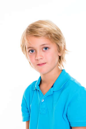 cute blonde: smiling blond boy in front of white background Stock Photo