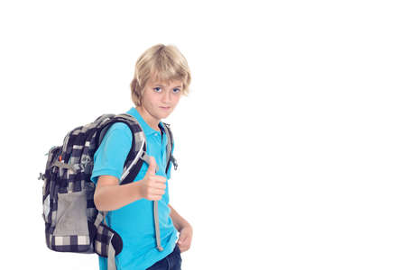 satchel: blond boy with satchel and thumb up in front of white background Stock Photo