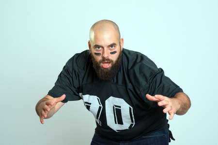 football jersey: bearded american football player is looking in to the camera