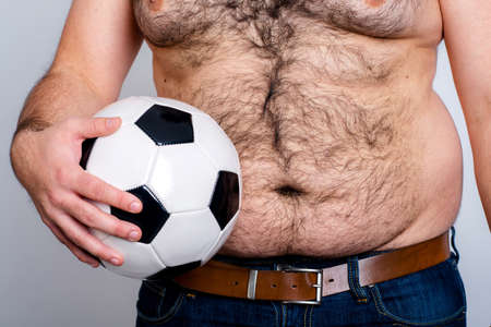 man office: portly belly of a man with black and white football