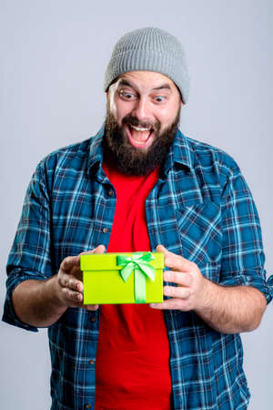 young bearded man with green gift box