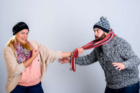 joking: young man and woman in winter dress joking Stock Photo